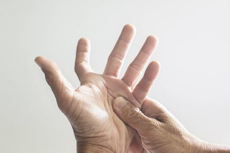 The hands and fingers of people Old with a problem showing sickness on a white background Фото со стока