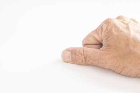 The skin, fingers and fingernails of the elderly showing gestures on a white background