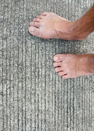 Picture of feet on an old concrete floor
