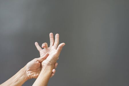 Hands and bones, rheumatoid fingers with inflammatory problems On a gray background