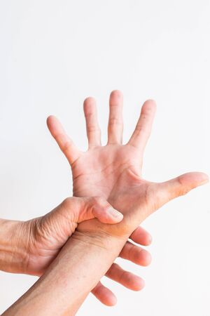 Hands with problems of deterioration of the bones of the elderly on the White Blackground