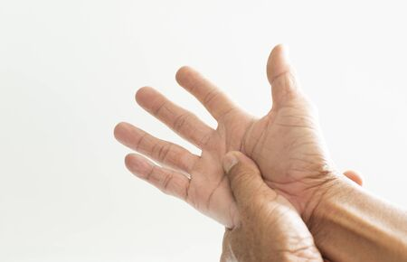The hands and fingers of people Old with a problem showing sickness on a white background