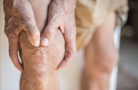 The knee of the elderly with muscle inflammation and bone degeneration