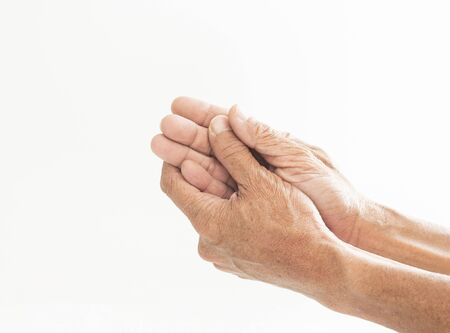Both hands of the elderly showing signs of abnormal hand and finger disorders
