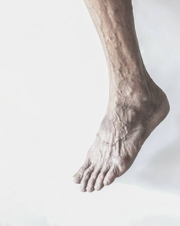 The feet and leg of the old man  Stock Photo