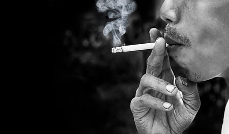 cigarette smoke: A man to smoking cigarette