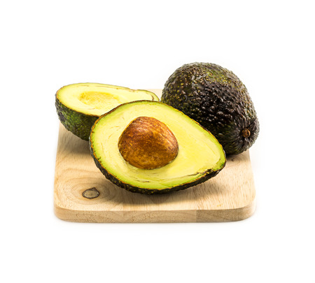 avocado on chopping board isolate on a white background Banco de Imagens