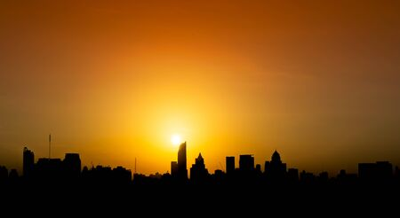 Silhouette the city in sunset for background Banco de Imagens