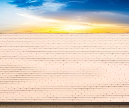 Roof tiles on sky sunset background