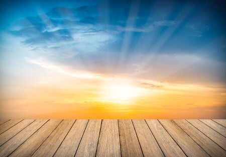 Wooden floor and sky sunset background