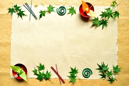japanese maple leaf and origami bird photo