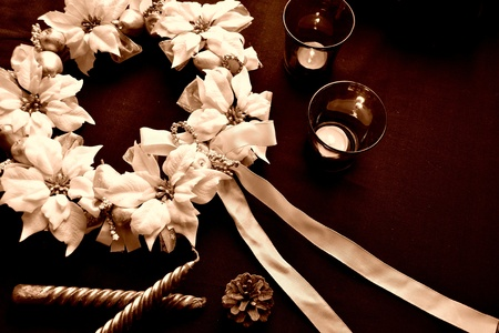 white poinsettia christmas wreath and candles 写真素材