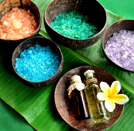Colorful bath salts with massage oil bottle Stock Photo