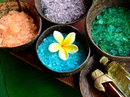 Colorful bath salts with massage oil bottle photo