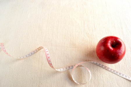 Apple with tape measure photo