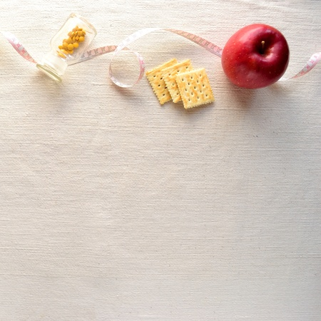 Apple,Healthy food with tape measure photo
