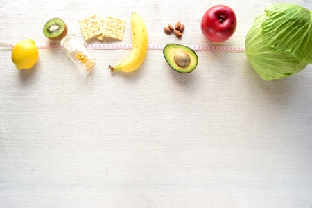 Healthy food and tape measure Stock Photo - 12934200