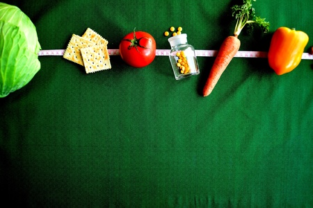 Vegetable,healthy food and tape measure Stock Photo