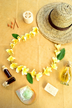 Straw hat,plumeria and spa supplies photo