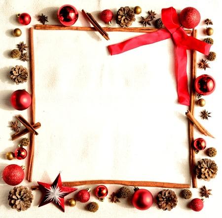 赤いリボンとクリスマスの飾りのフレーム 写真素材
