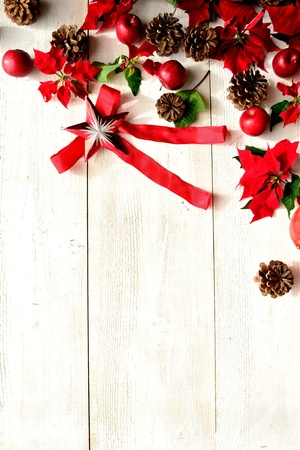 Red poinsettia with Christmas ornament Stock Photo