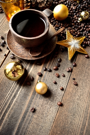Coffee cup,coffee beans and Xmas ornaments photo