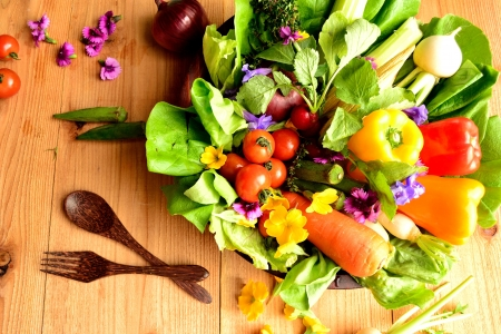 Fresh vegetables with spring flowers