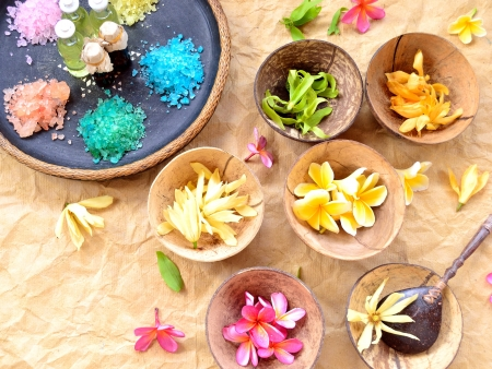 Colorful tropical flowers and spa supplies photo