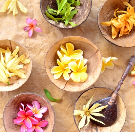 Colorful tropical flowers on coconut bowl