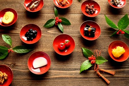 Japanese new year dishes on wood background