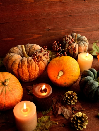 Colorful pumpkins with candles photo