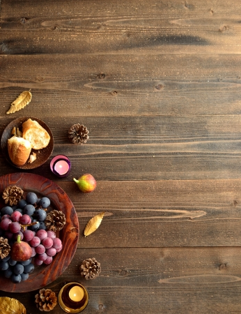 Grapes with bread wood background Stock Photo