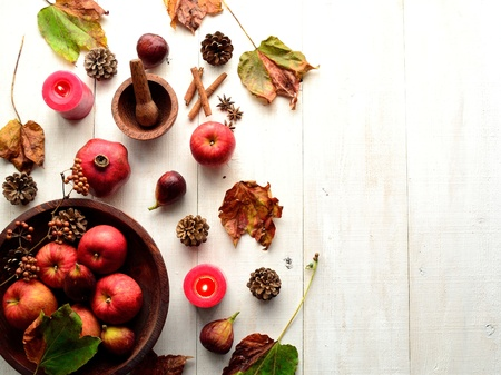 Red apple with fall leaf white wood background