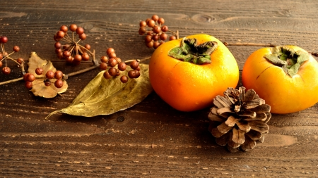 Persimmons,fall leaves and pine cones