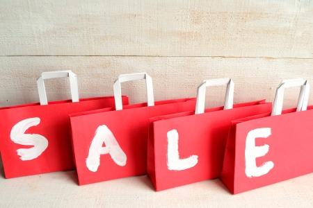 Rode koopje verkoop zakken