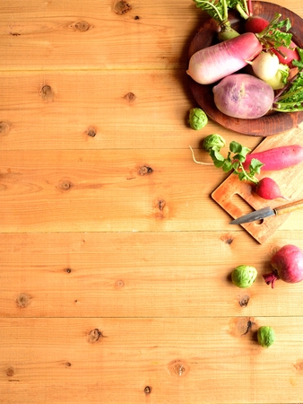 root vegetables: Colorful spring root vegetables with cutting board