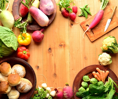 Colorful spring root vegetables with cutting board photo