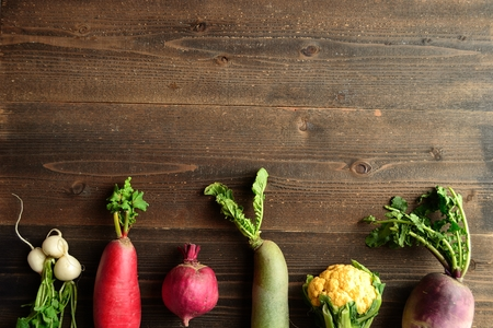 root vegetables: Colorful root vegetables with spring vegetables Archivio Fotografico