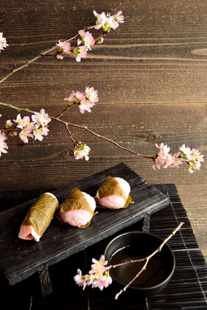 Japanese rice cake with cherry blossoms photo