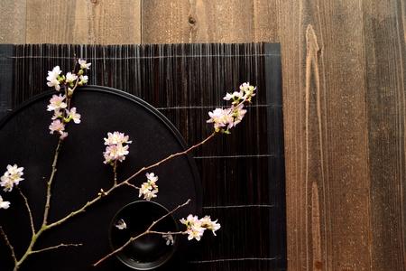 Cherry blossoms on Japanese black tray photo