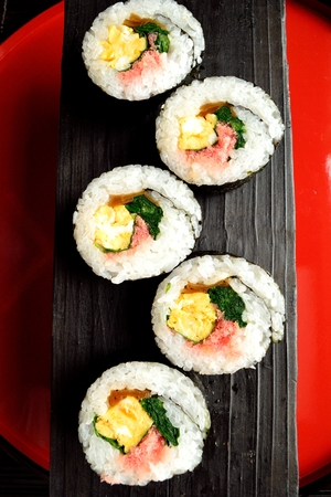 lacquer ware: Sushi roll on Japanese red tray