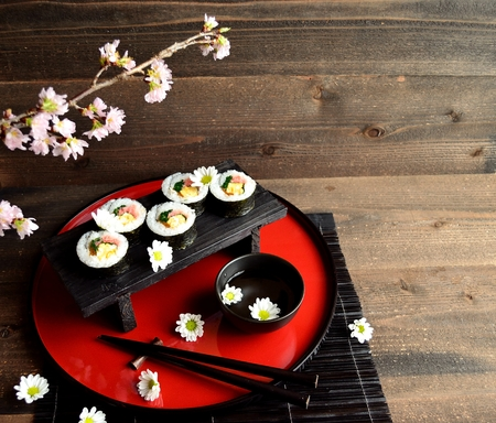 Sushi roll on Japanese red tray  photo