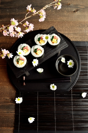 Sushi roll with cherry blossoms photo