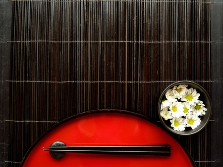 lacquer ware: Japanese red tray,chopsticks and flowers Stock Photo