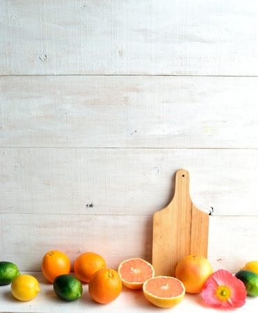 Citrus fruits,cutting board with poppy Stock Photo