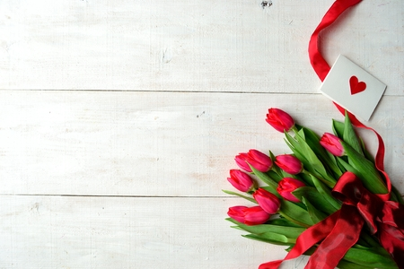 Bouquet of red tulips with message card