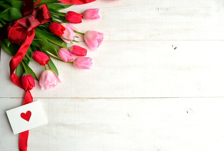 Bouquet of pink tulips with message card photo