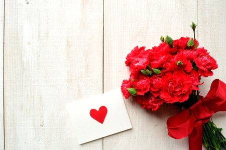 Red carnations bouquet with message card photo
