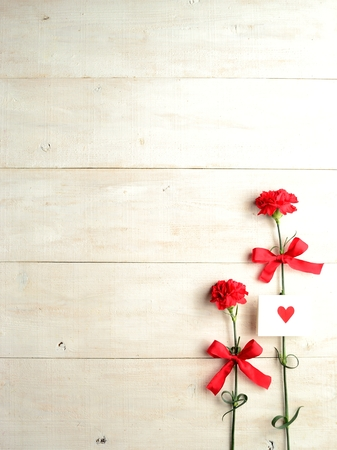 Red carnations with message card