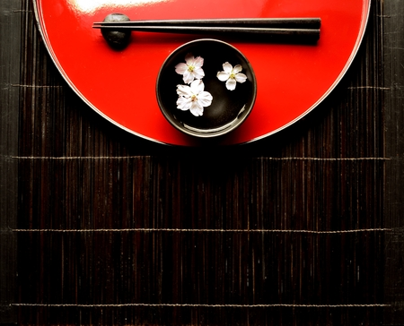 Japanese red tray,chopsticks and cherry blossoms